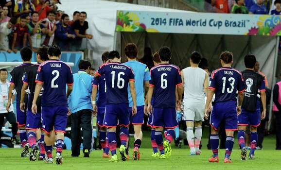 Japanese players leave the pitch after the group C World Cup soccer match between Ivory Coast and Japan at the Arena Pernambuco in Recife, Brazil, Saturday, June 14, 2014.  Ivory Coast won 2-1.  (AP Photo/Shuji Kajiyama) Photo: Shuji Kajiyama, Associated Press / AP