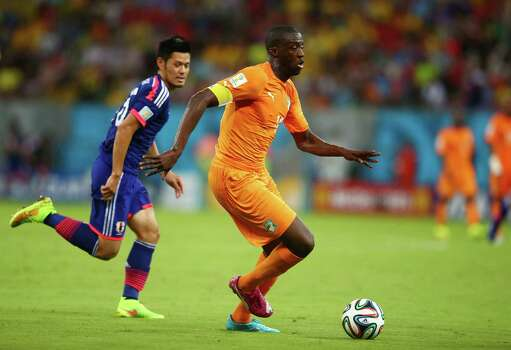 RECIFE, BRAZIL - JUNE 14: Yaya Toure of the Ivory Coast controls the ball against Hotaru Yamaguchi of Japan during the 2014 FIFA World Cup Brazil Group C match  between the Ivory Coast and Japan at Arena Pernambuco on June 14, 2014 in Recife, Brazil. Photo: Julian Finney, Getty Images / 2014 Getty Images