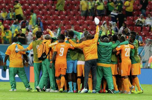 Ivory Coast players celebrate after the group C World Cup soccer match between Ivory Coast and Japan at the Arena Pernambuco in Recife, Brazil, Saturday, June 14, 2014.  Ivory Coast won 2-1.   (AP Photo/Shuji Kajiyama) Photo: Shuji Kajiyama, Associated Press / AP