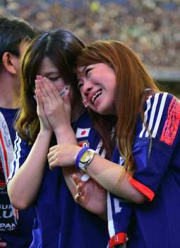 Japan's football supporters are disappointed as Japan was defeated by Ivory Coast in the group C match of the 2014 FIFA World Cup at the Tokyo Dome stadium in Tokyo on June 15, 2014. Japan was defeated by Ivory Coast 1-2.  AFP PHOTO / Yoshikazu TSUNOYOSHIKAZU TSUNO/AFP/Getty Images Photo: YOSHIKAZU TSUNO, AFP/Getty Images / AFP