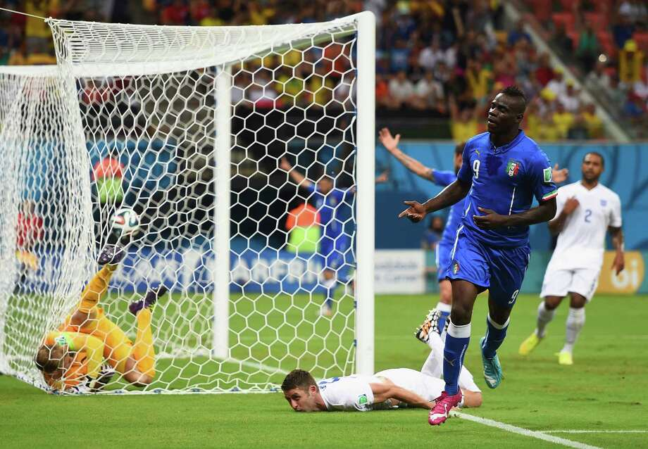 MANAUS, BRAZIL - JUNE 14:  Mario Balotelli of Italy celebrates after scoring his team's second goal on a header past Gary Cahill (C) and goalkeeper Joe Hart of England during the 2014 FIFA World Cup Brazil Group D match between England and Italy at Arena Amazonia on June 14, 2014 in Manaus, Brazil.  (Photo by Christopher Lee/Getty Images) *** BESTPIX *** Photo: Christopher Lee, Getty Images / 2014 Getty Images