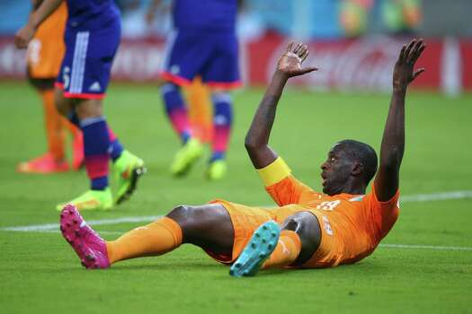 RECIFE, BRAZIL - JUNE 14: Yaya Toure of the Ivory Coast reacts during the 2014 FIFA World Cup Brazil Group C match  between the Ivory Coast and Japan at Arena Pernambuco on June 14, 2014 in Recife, Brazil. Photo: Julian Finney, Getty Images / 2014 Getty Images