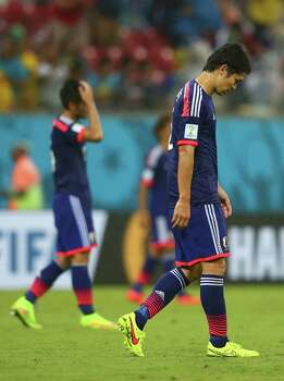 RECIFE, BRAZIL - JUNE 14:  A dejected Masato Morishige of Japan walks off the field after losing to the Ivory Coast 2-1 during the 2014 FIFA World Cup Brazil Group C match  between the Ivory Coast and Japan at Arena Pernambuco on June 14, 2014 in Recife, Brazil. Photo: Mark Kolbe, Getty Images / 2014 Getty Images