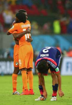 RECIFE, BRAZIL - JUNE 14: Gervinho of the Ivory Coast hugs a teammate after defeating Japan 2-1 during the 2014 FIFA World Cup Brazil Group C match  between the Ivory Coast and Japan at Arena Pernambuco on June 14, 2014 in Recife, Brazil. Photo: Mark Kolbe, Getty Images / 2014 Getty Images