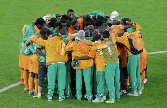 The team of Ivory Coast huddle after winning the group C World Cup soccer match between Ivory Coast and Japan at the Arena Pernambuco in Recife, Brazil, Saturday, June 14, 2014. Ivory Coast won 2-1. (AP Photo/Hassan Ammar) Photo: Hassan Ammar, Associated Press / AP