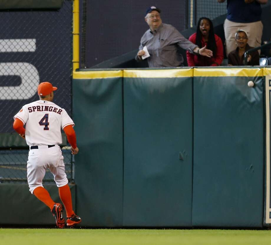 Astros right fielder George Springer chases a double during the third inning. Photo: Karen Warren, Houston Chronicle