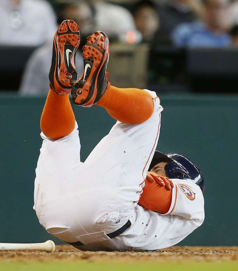 Astros right fielder George Springer reacts after being hit by a pitch during the third inning. Photo: Karen Warren, Houston Chronicle