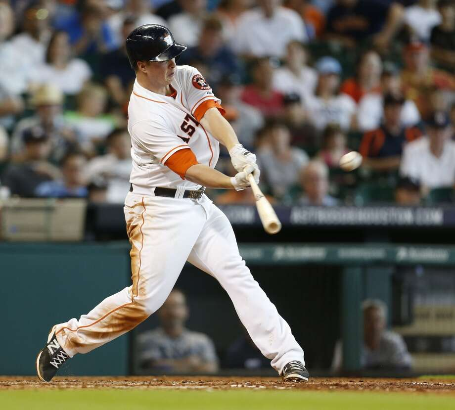 Astros third baseman Matt Dominguez hits during the third inning. Photo: Karen Warren, Houston Chronicle