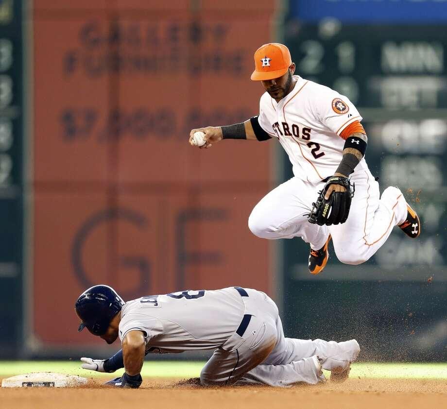 Astros shortstop Jonathan Villar jumps over Desmond Jennings during the fifth inning. Photo: Karen Warren, Houston Chronicle