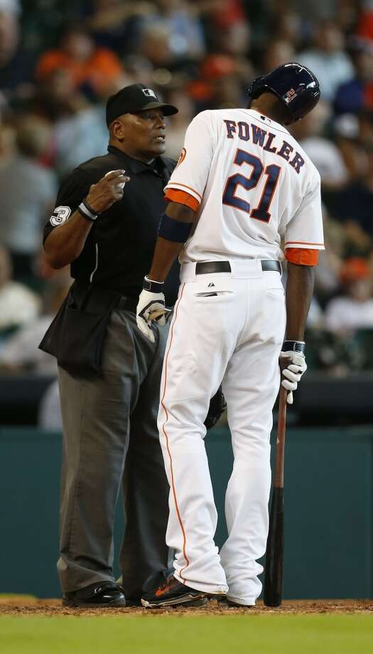 Astros center fielder Dexter Fowler argues with home plate umpire Laz Diaz after being called out on strikes during the sixth inning. Photo: Karen Warren, Houston Chronicle