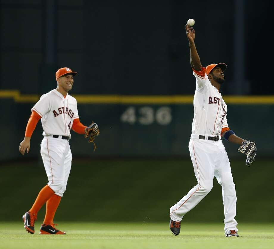 Astros right fielder George Springer, left, fools around with Dexter Fowler in the outfield during a pitching change in  the ninth inning. Photo: Karen Warren, Houston Chronicle
