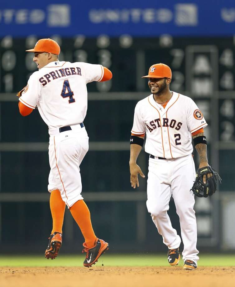 Astros right fielder George Springer (4) celebrates the Astros win with Jonathan Villar (2) after the final out. Photo: Karen Warren, Houston Chronicle