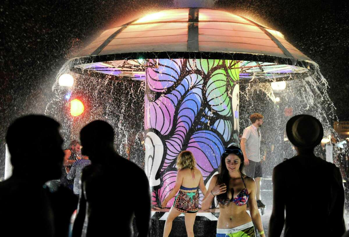 Festival-goers gather at the Fountain during the Bonnaroo Music & Arts Festival Thursday, June 12, 2014, in Manchester, Tenn.
