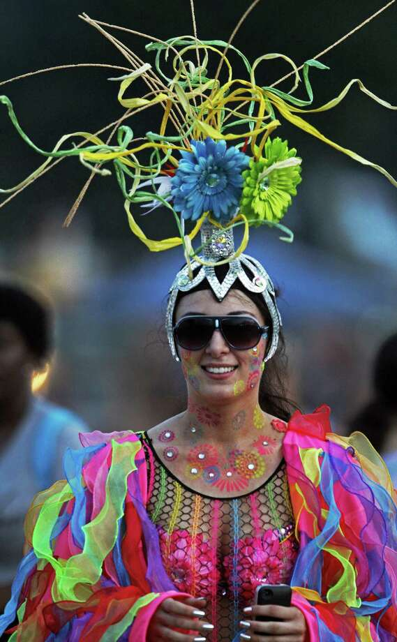 Valerie Biles is dressed in costume trying to be selected as Ms. Bonnaroo at the Bonnaroo Music & Arts Festival on Thursday, June 12, 2014, in Manchester, Tenn. (Photo by Wade Payne/Invision/AP) Photo: Wade Payne, AP / AP2014