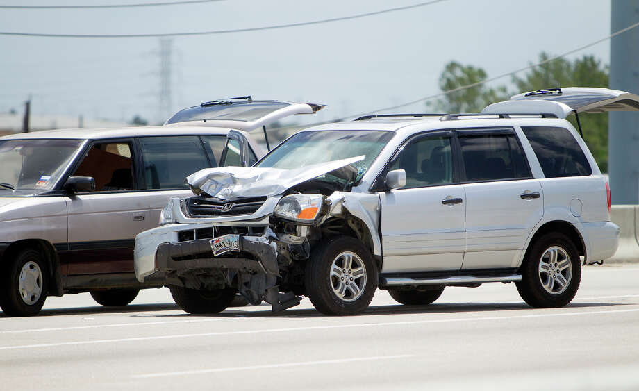 Two vehicles involved in a three-vehicle, fatal accident are seen along Highway 249 just North of Beltway 8, Sunday, June 15, 2014, in Houston. Photo: Cody Duty, Houston Chronicle / © 2014 Houston Chronicle