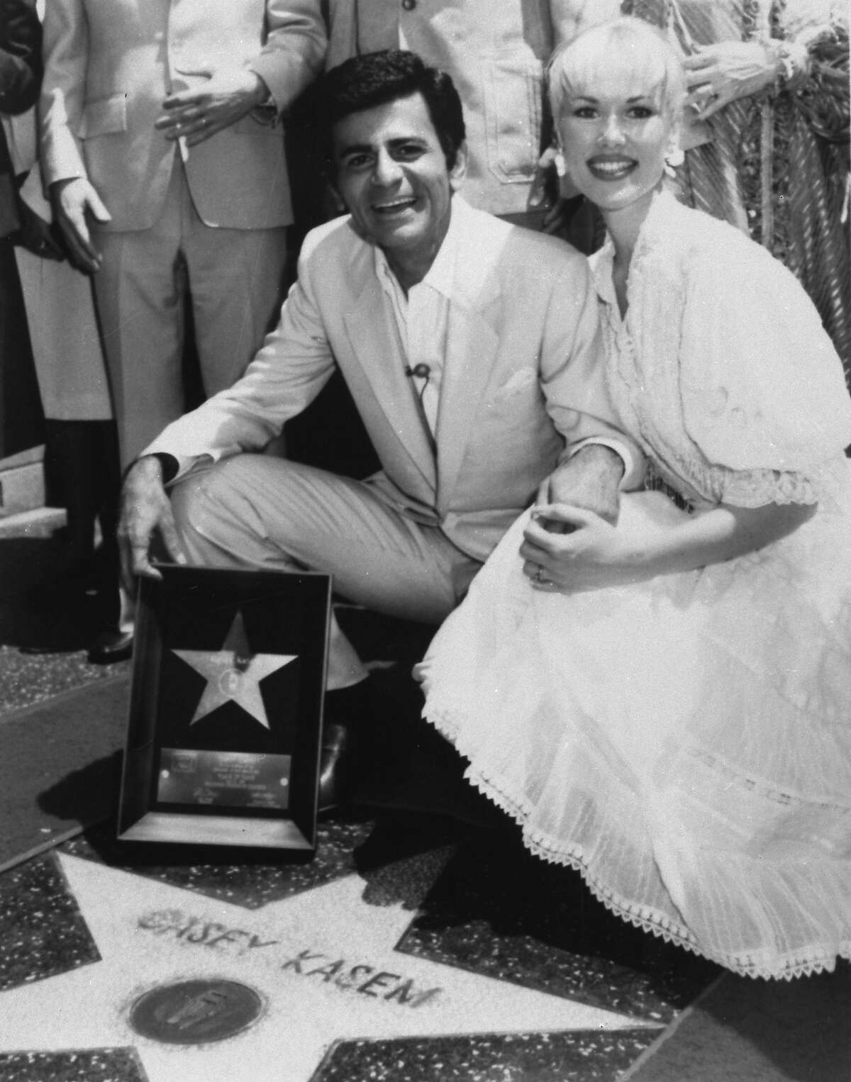 FILE - In this April 27, 1981 file photo, Casey Kasem and his wife Jean smile as he receives his own