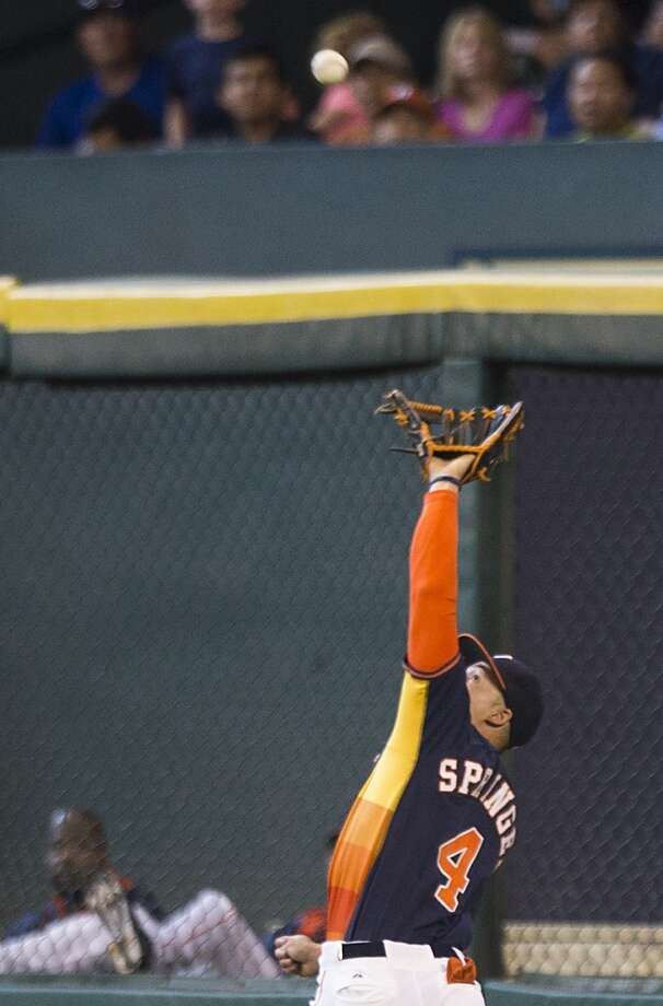 Astros right fielder George Springer reaches out to catch a long fly ball in right hit by Rays first baseman James Loney during the fifth inning. Photo: Brett Coomer, Houston Chronicle