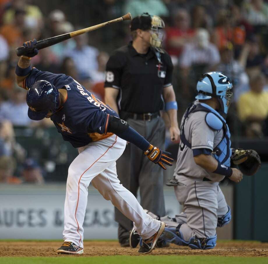 Astros catcher Carlos Corporan slams his bat on the ground after being stuck out by Rays starting pitcher David Price during the seventh inning. Photo: Brett Coomer, Houston Chronicle