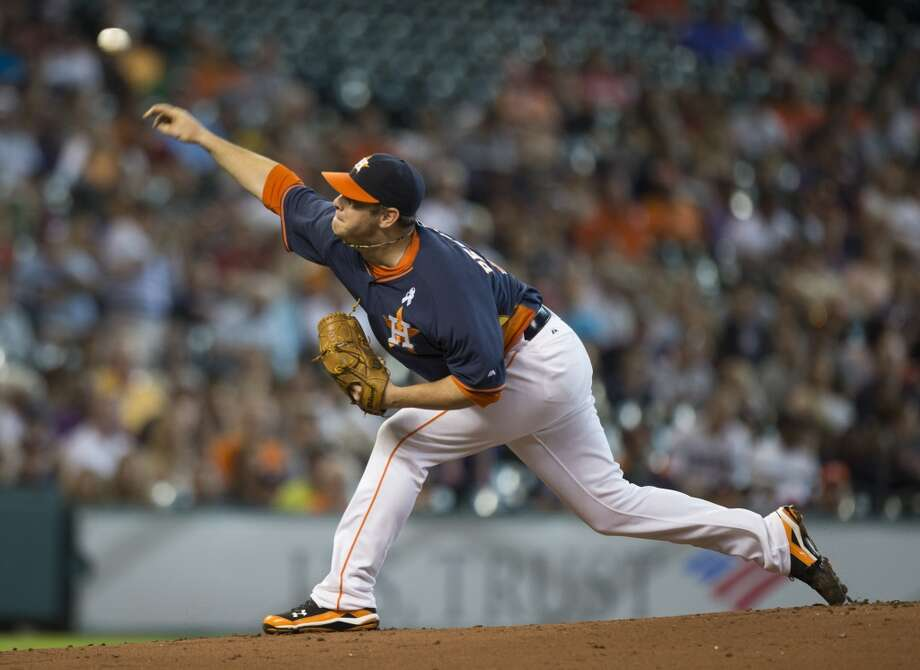 Astros starting pitcher Brad Peacock releases a pitch to Rays center fielder Desmond Jennings during the first inning. Photo: Brett Coomer, Houston Chronicle