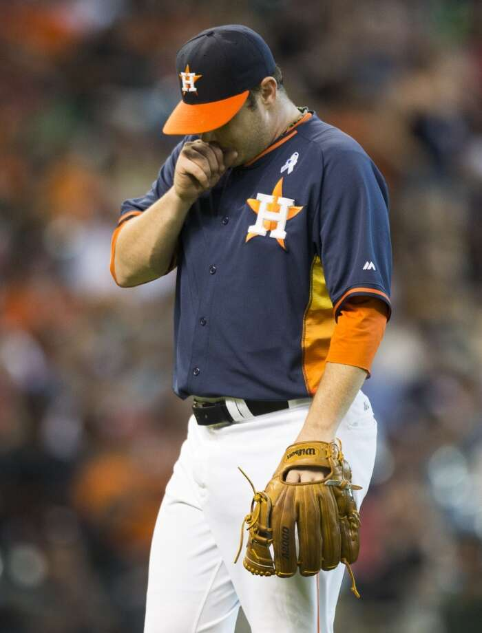 Astros starting pitcher Brad Peacock walks off the mound after getting out of a bases-loaded jam. Photo: Brett Coomer, Houston Chronicle