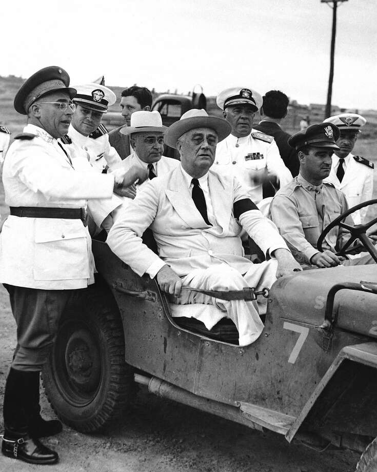 U.S. President Franklin D. Roosevelt and Brazil President Getulio Vargas (in rear seat with white hat) inspect an army base in Natal in 1943. Photo: Anonymous, Associated Press