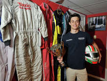 Stamford High School freshman Tazio Torregiani poses for a photograph next to his flame retardant racing suits at his home in Stamford, Conn., on Sunday, June 15, 2014. Torregiani races his go-karts all over the world. He has over 30 first place finishes in his career since he started at the age of six.