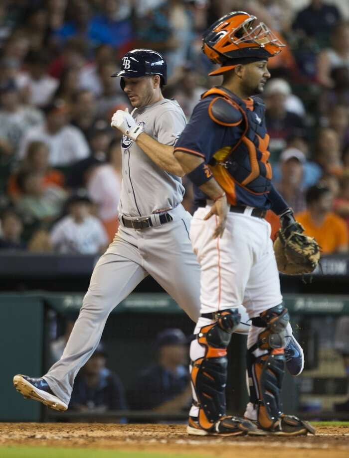 Rays left fielder Matt Joyce, left, scores past Astros catcher Carlos Corporan on an RBI single by Rays right fielder Jerry Sands during the eighth inning. Photo: Brett Coomer, Houston Chronicle