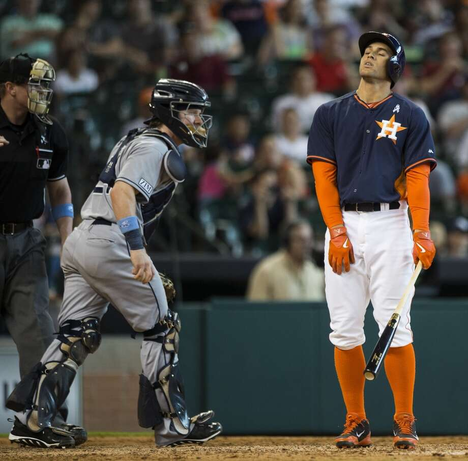 Rays catcher Ryan Hanigan runs off the field as Astros right fielder George Springer, right, reacts after striking out during the eighth inning. Photo: Brett Coomer, Houston Chronicle