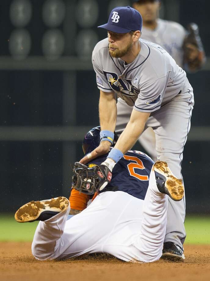 Astros shortstop Jonathan Villar (2) slides under the tag of Rays second baseman Ben Zobrist (18) to steal second base during the fifth inning. Photo: Brett Coomer, Houston Chronicle