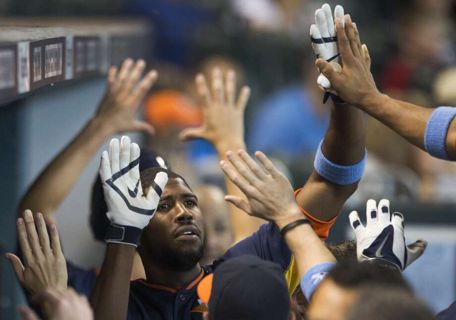 Astros center fielder Dexter Fowler celebrates his solo home run off Rays starter David Price during the first inning. Photo: Brett Coomer, Houston Chronicle