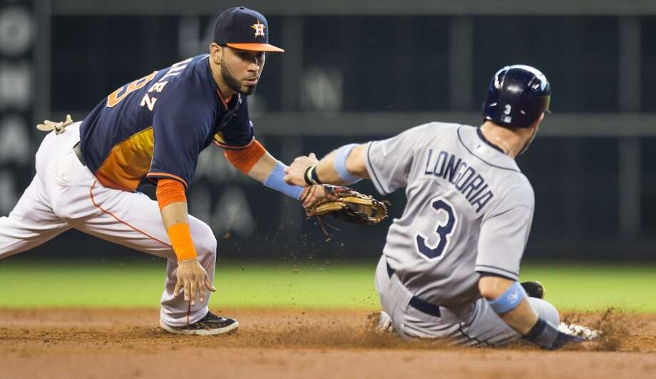 Rays third baseman Evan Longoria slides safely into second past the tag of Houston Astros shortstop Marwin Gonzalez during the third inning. Photo: Brett Coomer, Houston Chronicle