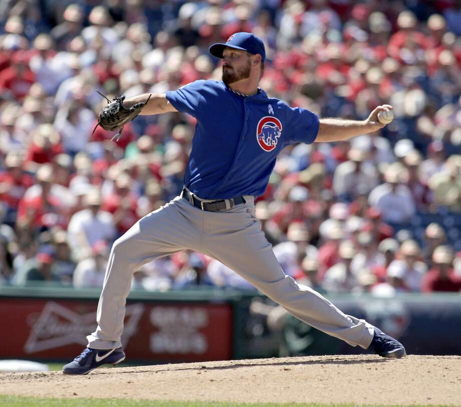 Chicago Cubs starting pitcher Travis Wood throws against the Philadelphia Phillies in the sixth inning of a baseball game on Sunday, June 15, 2014, in Philadelphia. The Cubs won 3-0. (AP Photo/H. Rumph Jr) Photo: H. Rumph Jr, Associated Press