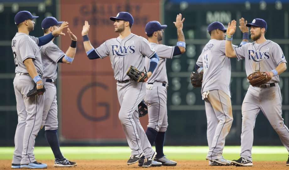 Rays players high five each other after the win. Photo: Brett Coomer, Houston Chronicle