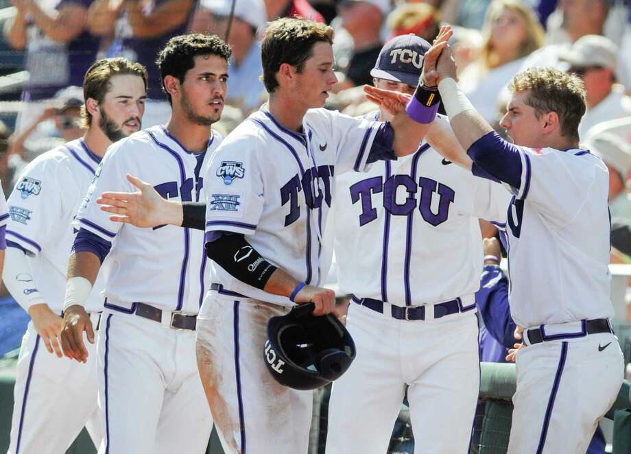 TCU's Keaton Jones, third right, celebrates with teammates after he scored against Texas Tech on a single by Cody Jones, in the eighth inning of an NCAA baseball College World Series game in Omaha, Neb., Sunday, June 15, 2014. (AP Photo/Eric Francis) Photo: Eric Francis, Associated Press / FR9944 AP