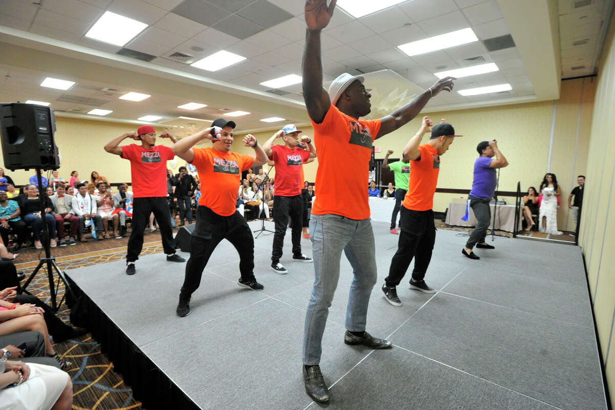 The 11 contestants take the stage during beginning of the Mr. Handsome competition at the Stamford Sheraton in Stamford, Conn., on Sunday, June 15, 2015.