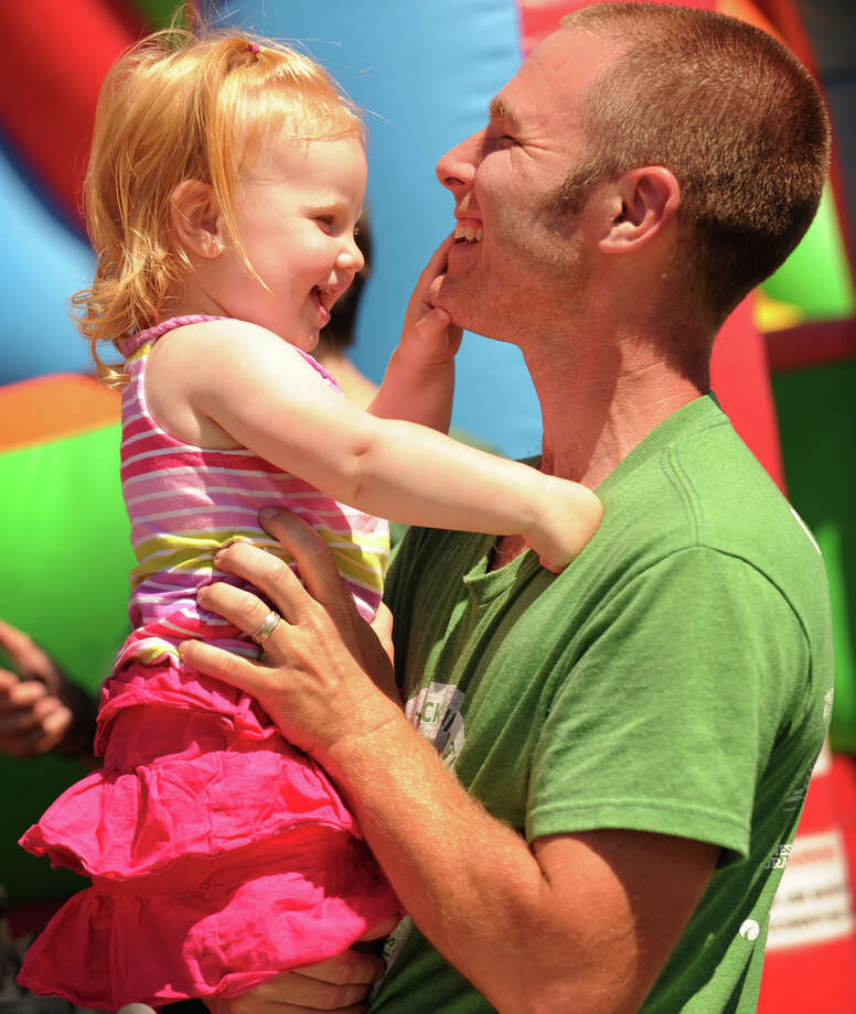 Chris Courtney and daughter Keara, 1, of Bridgeport, share a Father's Day moment at the annual Fairfield County Irish Festival at Fairfield University in Fairfield, Conn. on Sunday, June 15, 2014. Photo: Brian A. Pounds / Connecticut Post