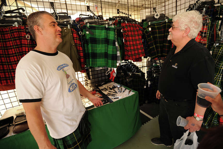 Chris Beyer, left, of Pennington, NJ, shows kilts from his company, American Highlander, to Tony Grasso, of Fairfield, at the annual Fairfield County Irish Festival at Fairfield University in Fairfield, Conn. on Sunday, June 15, 2014. Photo: Brian A. Pounds / Connecticut Post