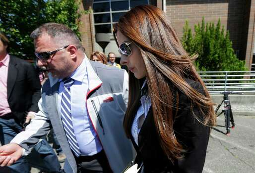 Kerri Kasem, right, the daughter of ailing radio personality Casey Kasem, leaves the Kitsap County Courthouse, Friday, May 30, 2014 in Port Orchard, Wash. Kasem was in court as part of an ongoing dispute with her stepmother Jean Kasem, over whether her father is receiving adequate medical care. Casey and Jean Kasem have been staying with family friends in Washington state. (AP Photo/Ted S. Warren) Photo: Ted S. Warren, STF / AP