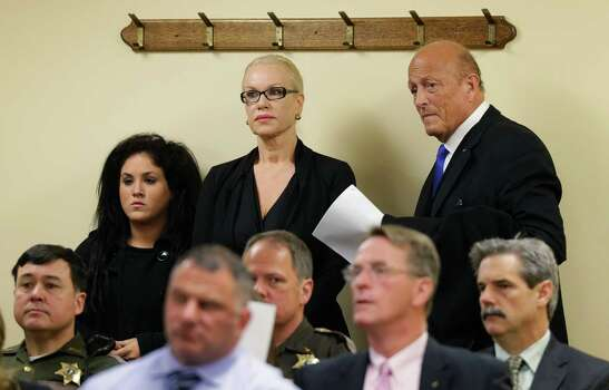 Jean Kasem, center, the wife of ailing radio personality Casey Kasem, waits with her attorney Joel Paget, right, and her daughter, Liberty Kasem, left, before appearing in Kitsap County Superior Court, Friday, May 30, 2014 in Port Orchard, Wash. Jean Kasem was in court as part of an ongoing dispute with her stepdaughter Kerri Kasem, who has been given authority to determine whether her father is receiving adequate medical care. Casey and Jean Kasem have been staying with family friends in Washington state. (AP Photo/Ted S. Warren) Photo: Ted S. Warren, STF / AP