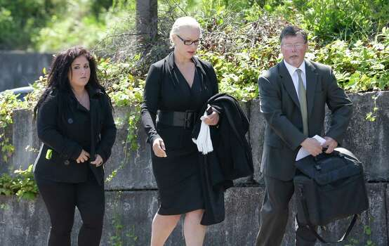 Jean Kasem, center, the wife of ailing radio personality Casey Kasem, walks with her daughter Liberty Kasem, left, and her attorney Steve Olsen, right, following a hearing in Kitsap County Superior Court, Friday, May 30, 2014 in Port Orchard, Wash. Jean Kasem was in court as part of an ongoing dispute with a stepdaughter who has been given authority to determine whether her father is receiving adequate medical care. Kasem and his wife have been staying with family friends in Washington state. (AP Photo/Ted S. Warren) Photo: Ted S. Warren, STF / AP
