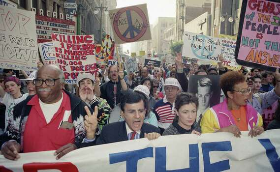 FILE - In this Jan. 26, 1991 file photo, entertainer Casey Kasem leads a group estimated at 15,000 people through the streets in Los Angeles protesting the United States' involvement in the Persian Gulf. Kasem, the smooth-voiced radio broadcaster who became the king of the top 40 countdown, died Sunday, June 15, 2014, according to Danny Deraney, publicist for Kasem's daughter, Kerri. He was 82. Photo: Bob Galbraith, AP / AP