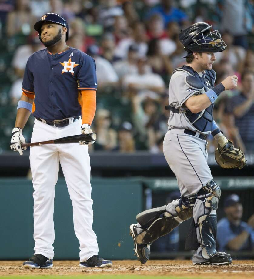 Astros pinch hitter Jon Singleton, left, reacts after striking out to end the ninth inning. Photo: Brett Coomer, Houston Chronicle