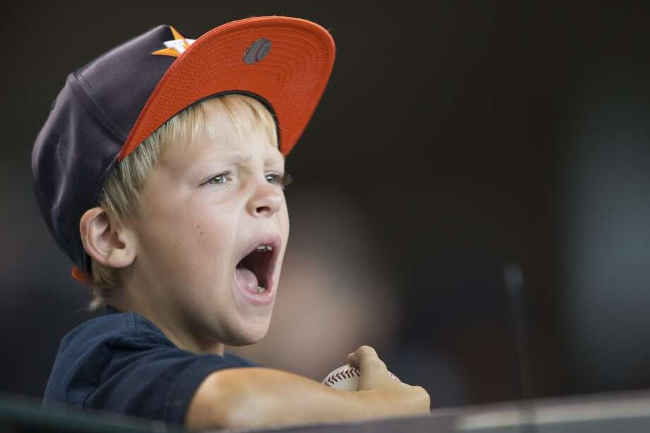 A young Astros fan cheers during the ninth inning. Photo: Brett Coomer, Houston Chronicle