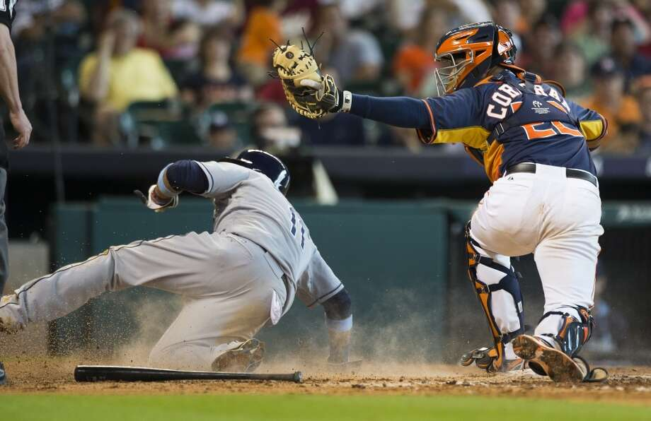 Astros catcher Carlos Corporan tags Rays shortstop Yunel Escobar out at home during the eighth inning. Photo: Brett Coomer, Houston Chronicle