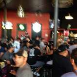 The newly-reopened Bar America is packed with folks waiting for the Game 5 tipoff on Sunday, June 15, 2014.