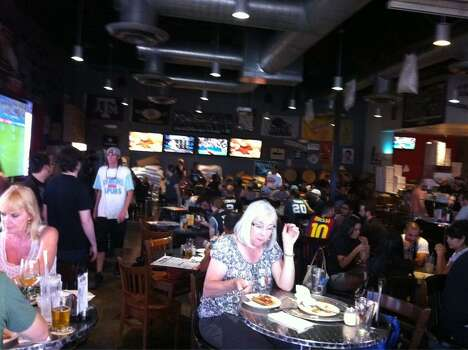 The tables at Freetail Brewing Co. are full in anticipation of Game 5, Sunday, June 15, 2014. Photo: Jennifer R. Lloyd, San Antonio Express-News