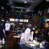 The tables at Freetail Brewing Co. are full in anticipation of Game 5, Sunday, June 15, 2014.