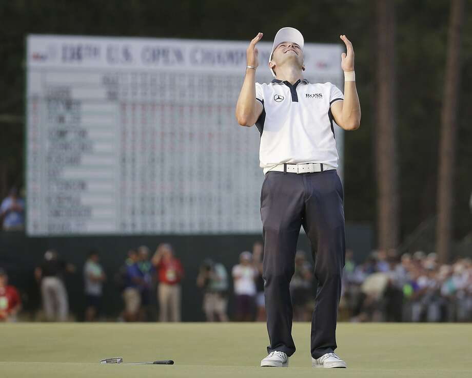 Germany's Martin Kaymer celebrates on the 72nd green after his wire-to-wire romp at Pinehurst. Photo: David Goldman, Associated Press