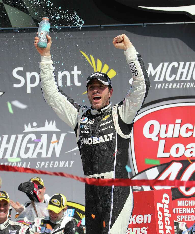 Jimmie Johnson acknowledges the fans after winning the NASCAR Quicken Loans 400 auto race at Michigan International Speedway in Brooklyn, Mich., Sunday, June 15, 2014. (AP Photo/Bob Brodbeck) ORG XMIT: MICO113 Photo: Bob Brodbeck / FR3471 AP
