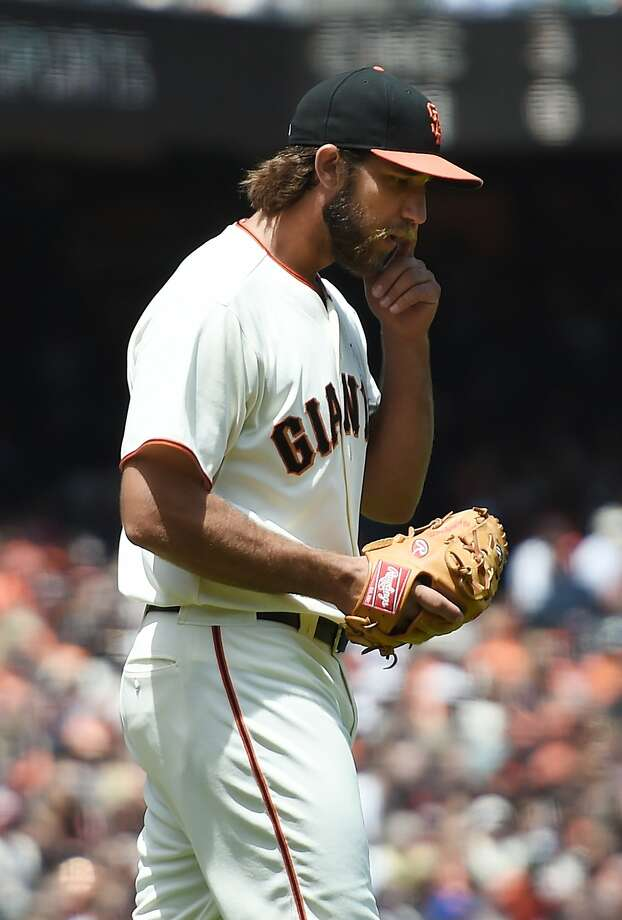 SAN FRANCISCO, CA - JUNE 15:  Madison Bumgarner #40 of the San Francisco Giants reacts after giving up a two-run homer to Troy Tulowitzki #2 of the Colorado Rockies in the top of the third inning at AT&T Park on June 15, 2014 in San Francisco, California.  (Photo by Thearon W. Henderson/Getty Images) Photo: Thearon W. Henderson, Getty Images